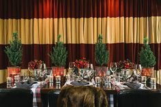 Plaid beautiful Christmas dinner table tablescape place setting love the buck deer napkin ring...love the plaid runners