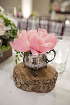 flowers in creamer (sugar bowl would be cute too) atop a natural wood stand