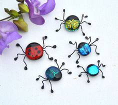 Fused glass bug in red with black dots, lady bug. ◅. ▻