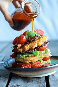 Avocado and Gouda BLT Corn Fritter Stacks with Chipotle Bourbon Dressing | halfbakedharvest.com » I want to eat this right now! I am hungry!