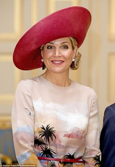 Queen Maxima showcased her signature style this afternoon as she opted for a wide brimmed ...