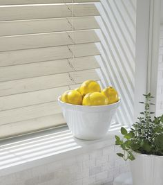 Draw attention with a brilliant spark of yellow and the natural woodgrain appearance of EverWood® alternative wood blinds.  ♦ Hunter Douglas window treatments