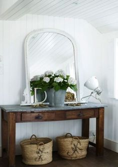 Pretty - I like the big white rimmed mirror on rustic dressing table with vintage make up spotlight