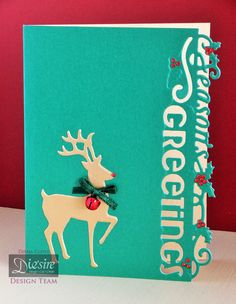 Diana Clews. Die'sire Edge'ables - Christmas Only Words – Seasons Greetings. Die'sire Classiques – Only Words – Christmas Blessings. Die'sire Classiques Christmas – Elegant Reindeer. Snow white Centura Pearl – Hint of Silver. Centura Pearl Christmas Green. Ribbon, Bell, gems. #crafterscompanion #Christmas