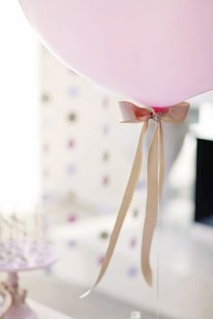 Ribbon bow at end of balloon