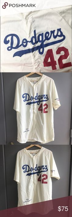 Jackie Robinson Dodgers Jersey Jackie Robison Los Angeles Dodgers Jersey. Formally the Brooklyn Dodgers. Jackie Robinson was the first black baseball player in the MLB and a hall of famer. This is a promotional replica of the 1955 season. Size XL. Vintage Shirts