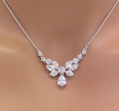 A simple but glamorous bridal necklace to add a touch of romance to your wedding! This necklace features an array of intricately cut CZ stones
