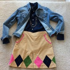 """Lily Pulitzer corduroy argyle skirt Super cute Lilly Pulitzer corduroy skirt. Khaki color with pink, navy and green argyle patches. Side pockets. Front kick pleat. (Pleat is not open) Hidden back zip and hook closure. Approx 17.25-17.5"""" long. Laying flat waist approx 15.5"""" across. 98 cotton 2 spandex. Size 2. Excellent condition. Lilly Pulitzer Skirts Mini"""