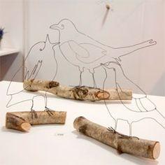Wire Wonderland wire sculptures on branches by Hayley Dix