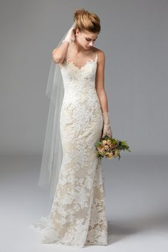 Watters Zella wedding dress -- Classic simplicity personifies Zella, which features our new Lyon Lace and a sheer, illusion neckline with buttons up the back. This gown features a slim, fit-and-flare silhouette and can be dressed up with a belt or overskirt. Chapel Train.