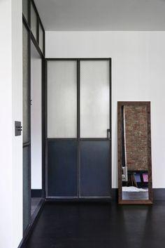 The Great Jones Loft is an industrial loft-style home in New York City, designed by Union Studio, a California-based interior design company. Ny Loft, New York Loft, Living Room Sliding Doors, Loft Style Homes, Loft Stil, Interior Window Shutters, Studio, Window Glazing, Style Deco