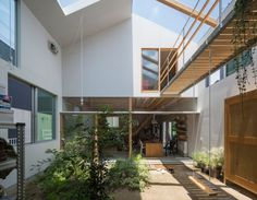 A simple gabled form glad in corrugated metal encloses a series of rooms arranged around an internal courtyard at this house in Kobe by Tato Architects. Architect House, Architect Design, Interior Garden, Interior And Exterior, Internal Courtyard, Timber House, Courtyard House, Ground Floor, Building A House