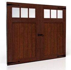 "The appearance of the Clopay Canyon Ridge Collection faux wood garage door varies greatly depending on the cladding ""species"", panel design and decorative hardware you choose. Design 1, REC 13 windows in a Walnut finish. www.clopaydoor.com."