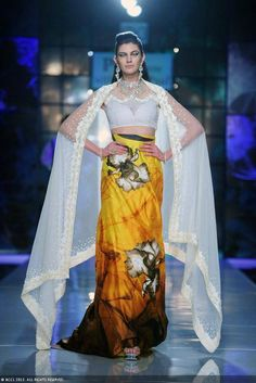 Olga Torovik showcases a creation by designer Satya Paul on Day 3 of Delhi Couture Week, held in New Delhi.
