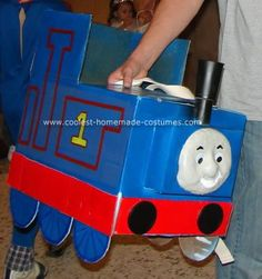 Homemade Thomas the Train Halloween Costume: For this Thomas the Train Halloween costume I used:  1 diaper box 2 cans of Primer spray paint 1 can of Blue Spray Paint 1 can of Red spray paint 1 can