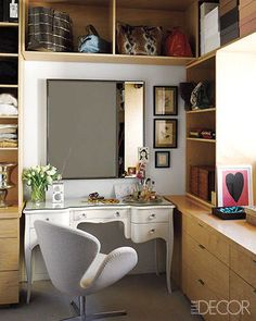 In an Upper East Side dressing room, an Arne Jacobsen Swan chair, a Swedish desk, a custom-made mirror, and vintage insect prints fill the space. Tour the entire home.   - ELLEDecor.com