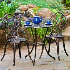 wrought iron chairs with upholstered cushions at an outdoor seating