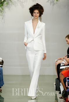 """Brides.com: . Pants. Two-legged separates made a major mark this season. From tailored tuxedos to a boho wide-leg pair of pants with a ruffled top, in the Spring 2016 world, dresses no longer dominate wedding-day attire.  """"Ellen"""" long sleeve pearl white trouser suit with a V-neck, Theia"""