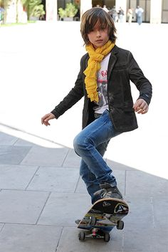 Fun & Fun Boys. Casual cool styled boy skateboarding.