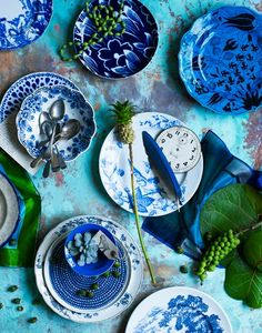This collected mix of blue and white china is more interesting than a set of one pattern would be.