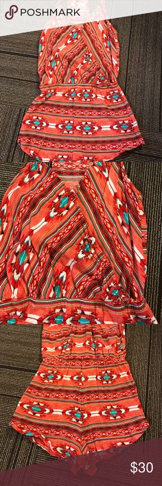 Tribal print romper Super cute red white and real tribal print romper. The romper was purchased online and is a size medium, however fits more like an XS. Never worn because it was too small! Pants Jumpsuits & Rompers