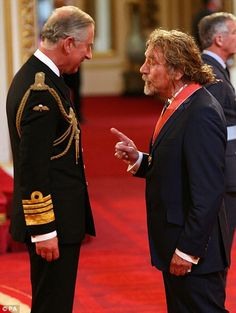Call this a party? Plant receives his CBE from the Prince of Wales at Buckingham Palace
