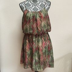 Elastic waist dress This is a cute dress with spaghetti straps and an elastic waist. Size is large. 100% polyester. Excellent condition with no stains or tears. Final Touch Dresses
