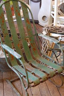 LOVE this metal chair  Never saw this design before