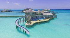 These villas in the Maldives have slides that take you right into the water #MaldivesHoliday