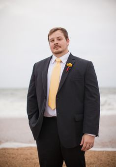 A dashing groom. Photographed by Genevieve Stewart Moving Art Productions http://www.outerbanksweddingassoc.org/membersearch/memberpage.html?MID=1888=Photographers=16