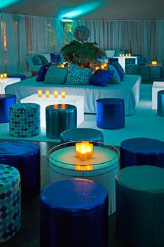 Create a blue underwater world with modern metallic and patterned pods and chic blue uplighting.