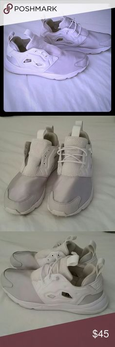 PRICE DROP! REEBOK SNEAKERS Beautiful silver and white reebok sneakers. I bought them on posh brand new and received them with only one shoe lase. Worn once, they're fabulous just need to buy laces. Reebok Shoes