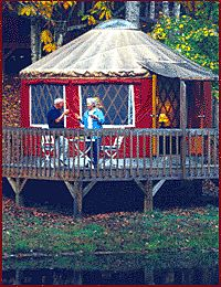stay in a Yurt near Asheville -   The Falling Water Yurts are 16 foot diameter circular tent-style structures, with outdoor decks, skylights, french doors, windows, ceiling fans, queen size beds, refrigerators, stereo-CD, coffee makers, and polished knotty pine floors with area rugs.