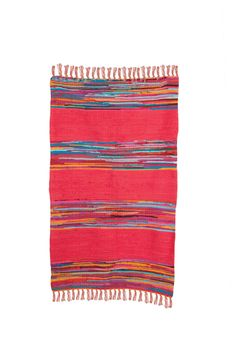 This Mexican style colourful rag rug, features plain panels in red or turquoise with striped panels in between, and fringing at the end. Dimensions :90x150cm