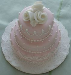 Pink 3 tiered mini cake with white flowers