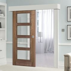 Thruslide Surface Vancouver Walnut Sliding Door and Track Kit- Clear Glass - Prefinished - Lifestyle Image. Hand Injuries, Plates On Wall, Sliding Doors, Bathroom Medicine Cabinet, Clear Glass, Woodworking Plans, New Homes, Decorating Ideas, Interiors
