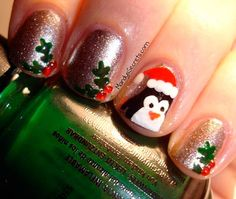 Penguin mistletoe nail art for Christmas fun. See the full list here.