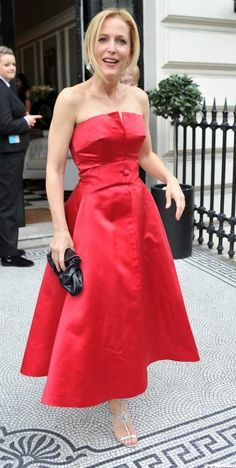 The gorgeous Gillian Anderson at the Tatler UK Lesbian Ball wearing 1958 Dior in scarlet red silk from WilliamVintage. #vintage #fashion