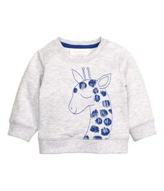 Long-sleeved sweatshirt with a printed motif at front, a snap fastener on each shoulder, and ribbing at cuffs and hem.