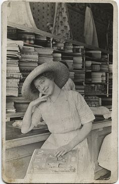 Oooooh, I wish I could transport myself to this lovely shop right now!  Imagine all the beautiful trims, buttons and fabrics, sigh... She holding a magazine that is titled Do It Now....