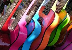 Love this instrument and music is my life!!! Bebe'!!! Rainbow row of guitars!!!