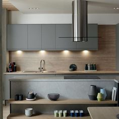 40 Inspiring Dark Grey Kitchen Design Ideas Ordinary more current and better kitchen designs are brought into the market thus what might request today might be out of style a couple of months after the fact. Grey Kitchen Cupboards, Dark Grey Kitchen, Handleless Kitchen, Kitchen Units, Home Decor Kitchen, New Kitchen, Kitchen Ideas, Howdens Kitchens, Howdens Kitchen Clerkenwell