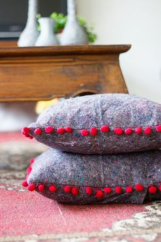 Pom trimmed pillow on painter's cloth base. Fantastic!