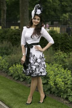 Actress Aishwarya Rai Bachchan, who has been a regular at the Royal Ascot horse race meeting since 2009, was elegant in a black and white lace dress. Ash, who is the brand ambassador of Longines, finished her look by adding a royal touch a hat. (AP)