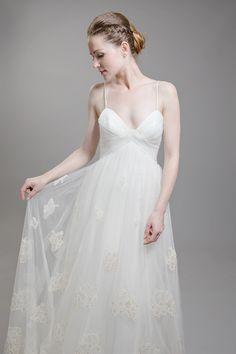 Beautiful spaghetti strap lace detailed white wedding dress.
