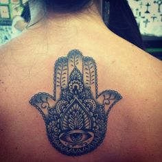 Hamsa Tattoo. The Hamsa is an ancient Middle Eastern amulet symbolizing the Hand of God. In all faiths it is a protective sign. It brings it's owner happiness, luck, health, and good fortune.
