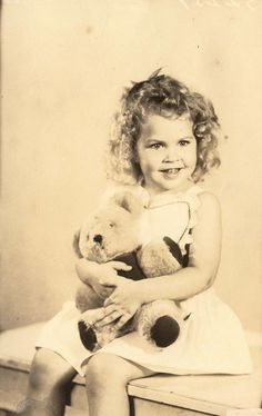 vintage photo of child and teddy bear