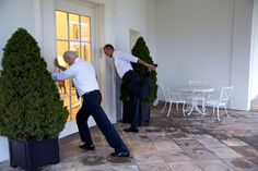 """President Barack Obama and Vice President Joe Biden participate in a """"Let's Move!"""" video taping on the Colonnade of the White House, Feb. 21, 2014."""