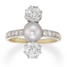 Edwardian diamond and cultured pearl three-stone ring circa 1910,