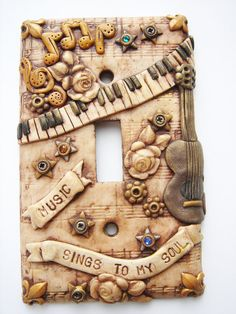 Music steampunk switch plate 1 handmade by Marie Segal.